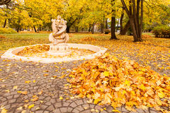 Empty fountain and pile of leaves Royalty Free Stock Photo