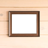 Empty frame. On wooden wall Stock Photography