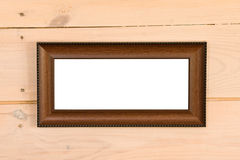 Empty frame. On wooden wall Royalty Free Stock Images