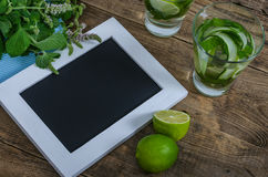 Empty frame with black background, lime, mint and cucumber lemon Stock Photography