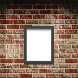 Empty frame on a brick wall. Royalty Free Stock Photo