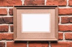 Empty frame on brick wall stock image