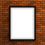 Empty frame on brown brick wall Royalty Free Stock Image