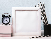 Empty frame, clock and paper straws Stock Images