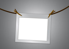 Empty frame and clothespin on rope Royalty Free Stock Image
