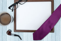 Empty frame and coffee on the table Royalty Free Stock Images