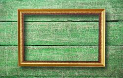Empty frame with copyspace. Hanging on creative green wooden background Stock Images