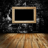 Empty frame in dark room Stock Photo