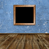 Empty frame in dark room. Empty frame in dark grunge room Royalty Free Stock Photos