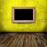Empty frame in dark room Royalty Free Stock Images