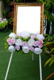 Empty frame with flower in wedding Stock Photo