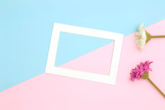 Empty frame and flowers flat lay Stock Photography