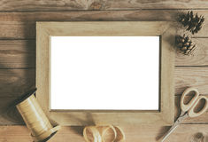 Empty frame gift wrapping concept. Empty frame and gift wrapping items. Mock up on wooden background stock photo