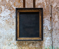 Empty frame from an icon in prison cell. Royalty Free Stock Image