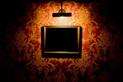 Empty frame with lamp Royalty Free Stock Photo