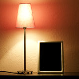 Empty frame and lamp Royalty Free Stock Photos