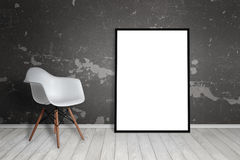 Empty frame leaning on wall. Chair beside.  Royalty Free Stock Photography