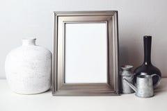 Empty frame mock up for presentation artwork. Template framing for modern art. Silver blank Frame. Empty frame mock up for presentation artwork. Template stock photography
