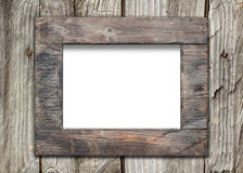 Empty frame on old wooden surface Royalty Free Stock Image