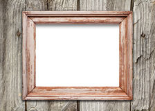 Empty frame on old wooden surface. Front view of a blank wooden frame over a weathered wooden surface stock photo