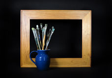 Empty Frame with Paint Brushes Royalty Free Stock Photo