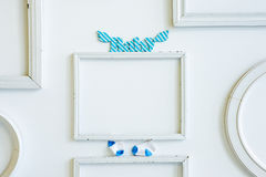 Empty frame for photograph, dwith wooden letters Baby and little socks Royalty Free Stock Photo