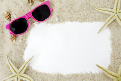 Empty frame with sand and sunglasses royalty free stock photos