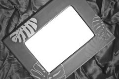Empty frame on silk in black and white tone. Frame on silk in black and white tone royalty free stock photo