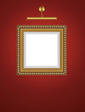 Empty frame on the wall with lamp. Royalty Free Stock Image