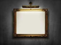 Empty frame on the wall. Picture frame with blank canvas hanging on a wall in an art museum Stock Photos