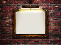 Empty frame on the wall. Picture frame with blank canvas hanging on a brick wall in art museum Royalty Free Stock Images