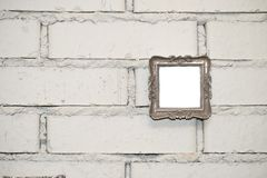 empty frame on a white brick wall royalty free stock photography