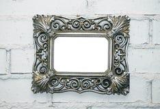 Empty frame on a white brick wall. Empty vintage photo frame on a white brick wall, copy space royalty free stock photo