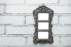 Empty frame on a white brick wall. Empty vintage photo frame on a white brick wall, copy space stock photography