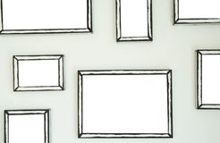 Empty frame on white wall  .Blank space for text and images.  stock photos