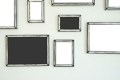 Empty frame on white wall  .Blank space for text and images.  stock image