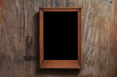 Empty frame on wooden background Royalty Free Stock Photos