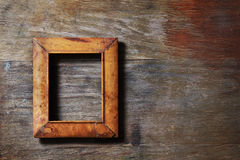 Empty frame on wooden background Royalty Free Stock Images