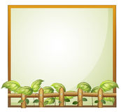 An empty frame with a wooden fence and vine plants Stock Images