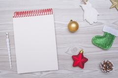 Empty frame on wooden table with christmas decoration elements. Top view. Stock Photography
