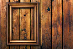 Empty frame on wooden wall Royalty Free Stock Photos
