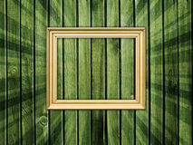 Empty frame on wooden wall Stock Photography