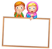 An empty framed white board with two girls Stock Image