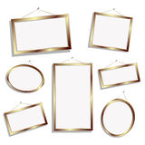 Empty frames. Golden empty frames, isolated objects over white background Royalty Free Stock Photo