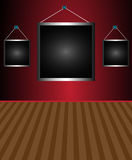 Empty frames. Abstract colorful illustration with three empty frames hanging on a red wall Stock Photo