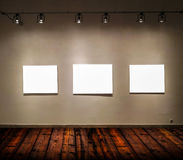Empty frames in big gallery room Royalty Free Stock Photo