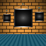 Empty frames on a brick wall Royalty Free Stock Photography