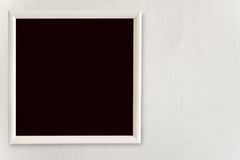 Empty frames hang on the white walls. Empty blackboard hang on the white walls Royalty Free Stock Image