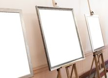 Blank empty frames on painting easel, background Royalty Free Stock Photography