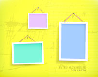 White frames on the wall. Empty frames of picture on the grunge old wall. Eps 10 vector illustration. Used opacity layers for effect of shadows royalty free illustration